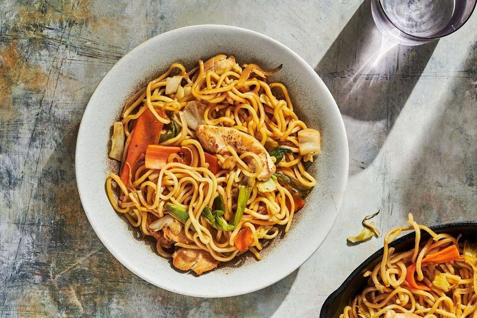 """<p>The key to a good yakisoba is the noodles and the sauce. You can often find refrigerated yakisoba noodles in the supermarket in a small plastic pack but if you can't find them, you can go for something like spaghetti or even well drained ramen in a pinch.</p><p>Get the <a href=""""https://www.delish.com/uk/cooking/recipes/a35819009/chicken-yakisoba-recipe/"""" rel=""""nofollow noopener"""" target=""""_blank"""" data-ylk=""""slk:Chicken Yakisoba"""" class=""""link rapid-noclick-resp"""">Chicken Yakisoba</a> recipe.</p>"""
