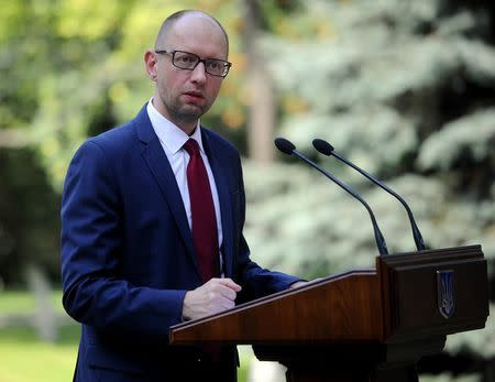 Ukrainian Prime Minister Arseny Yatseniuk delivers a speech in Kiev
