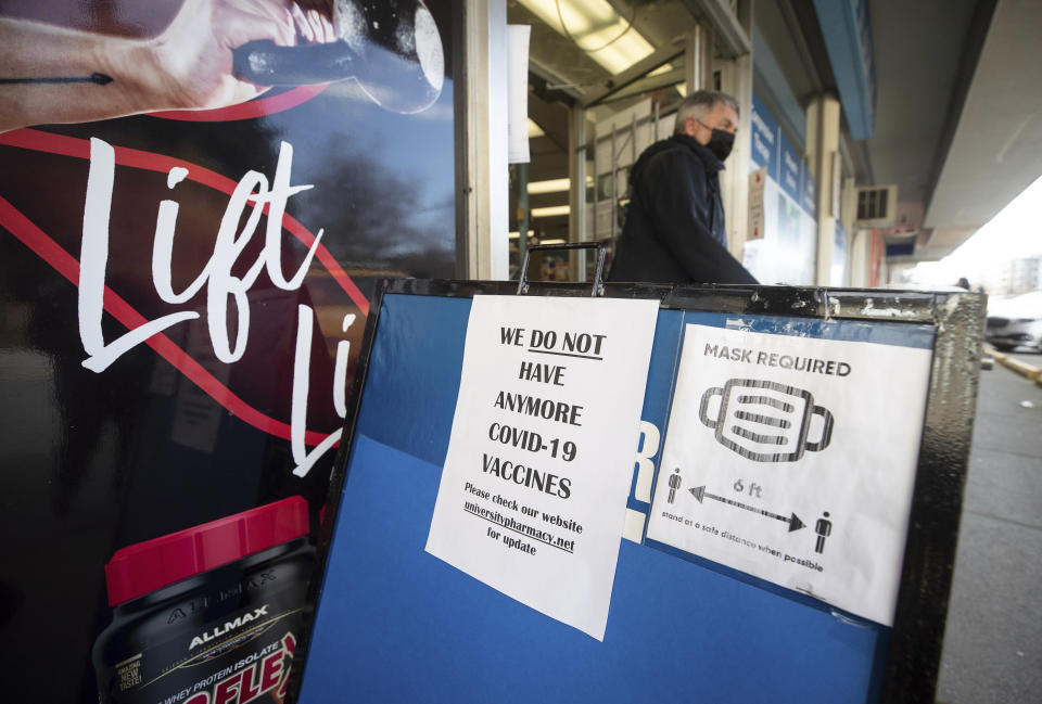 FILE - A sign indicating that there are no more vaccines available is seen outside University Pharmacy in Vancouver, British Columbia, Thursday, April 1, 2021. With seven teams based in Canada, which has had a much slower vaccine rollout than the U.S., hockey is dealing with an outbreak in Vancouver and uneasiness north of the border. (Darryl Dyck/The Canadian Press via AP, File)