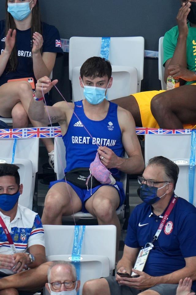Great Britain's Tom Daley knits in the stands during the Women's 3m Springboard Final at the Tokyo Aquatics Centre on the ninth day of the Tokyo 2020 Olympic Games in Japan. Picture date: Sunday August 1, 2021