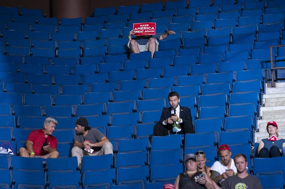Supporters of President Donald Trump wait for his arrival for a campaign rally at the BOK Center, Saturday, June 20, 2020, in Tulsa, Okla. (AP Photo/Evan Vucci)