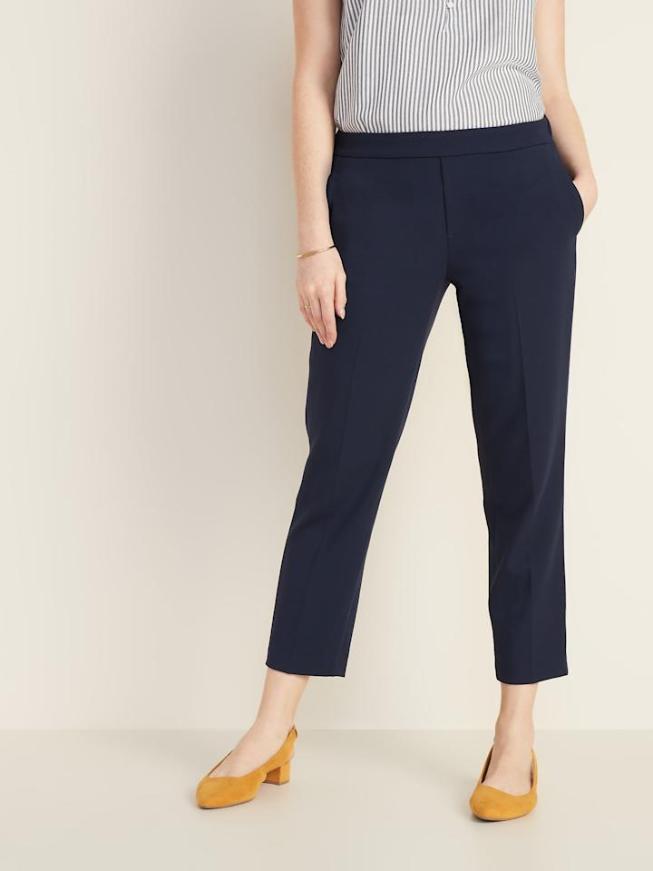 "<p><a href=""https://www.popsugar.com/buy/Old-Navy-Mid-Rise-Pull--Straight-Pants-549004?p_name=Old%20Navy%20Mid-Rise%20Pull-On%20Straight%20Pants&retailer=oldnavy.gap.com&pid=549004&price=35&evar1=fab%3Aus&evar9=47218303&evar98=https%3A%2F%2Fwww.popsugar.com%2Ffashion%2Fphoto-gallery%2F47218303%2Fimage%2F47218346%2FOld-Navy-Mid-Rise-Pull-On-Straight-Pants&list1=shopping%2Cold%20navy%2Ceditors%20pick%2Cpants%2Cworkwear%2Cspring%20fashion%2Cfashion%20shopping&prop13=api&pdata=1"" rel=""nofollow"" data-shoppable-link=""1"" target=""_blank"" class=""ga-track"" data-ga-category=""Related"" data-ga-label=""https://oldnavy.gap.com/browse/product.do?pid=394202022&amp;cid=1061987&amp;pcid=5475&amp;vid=1&amp;grid=pds_10_20_1#pdp-page-content"" data-ga-action=""In-Line Links"">Old Navy Mid-Rise Pull-On Straight Pants</a> ($35)</p>"
