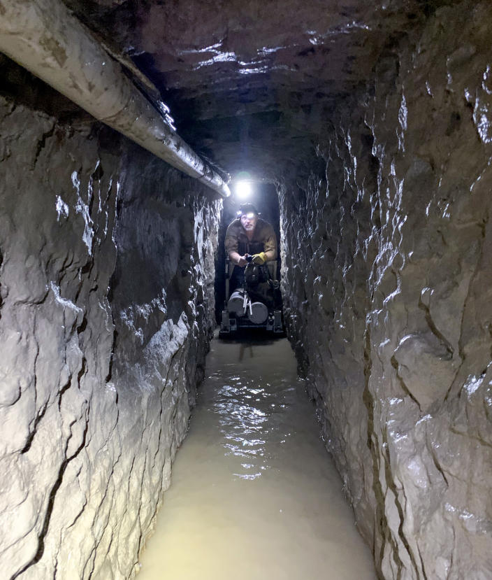 Image: U.S. Customs and Border Protection agents required oxygen canisters while mapping out the drug smuggling tunnel.