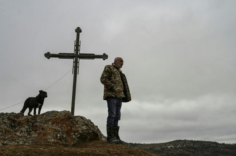 A resident of Shurnukh village looks towards an Azeri military camp now based in the village