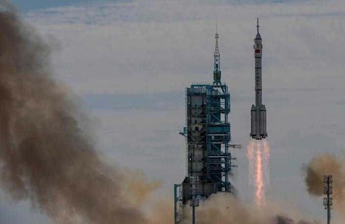 The manned Shenzhou-12 spacecraft from China's Manned Space Agency onboard the Long March-2F rocket launches with three Chinese astronauts onboard at the Jiuquan Satellite Launch Centre (Getty)