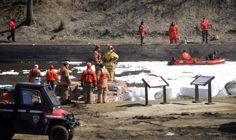 Crews search for the body of Lyle Eagletail in the Big Sioux River below the falls at Falls Park in Sioux Falls, S.D. Saturday, March 16, 2013. Eagletail and 16-year-old Madison Wallace dove into the water on Thursday to rescue 6-year-old Garrett Wallace who did survive. Madison's body was recovered on Friday afternoon and Eagletail's on Saturday. (AP Photo/Argus Leader, Elisha Page)