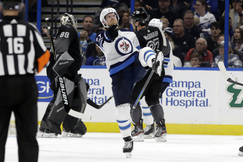 Winnipeg Jets left wing Nikolaj Ehlers (27) celebrates his goal against the Tampa Bay Lightning during the second period of an NHL hockey game Saturday, Nov. 16, 2019, in Tampa, Fla. (AP Photo/Chris O'Meara)