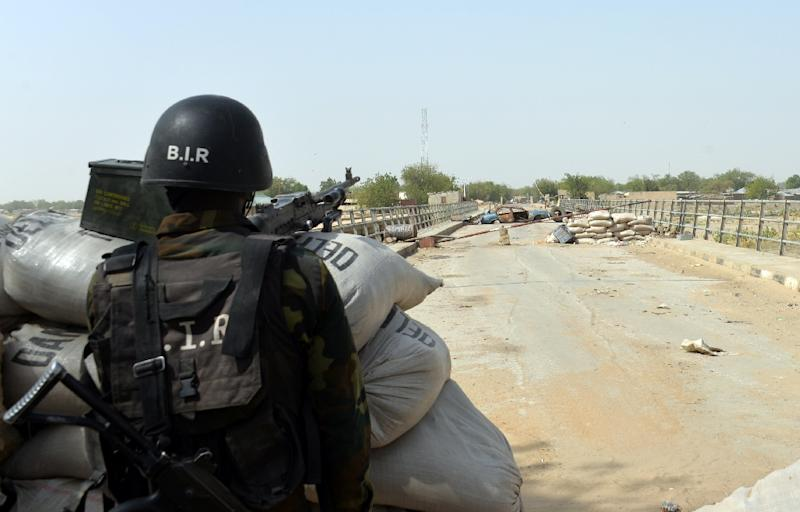 A Cameroonian soldier stands post in the town of Fotokol, on the border with Nigeria, on February 17, 2015