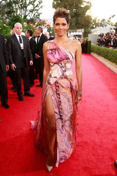 """<div class=""""caption-credit""""> Photo by: Getty Images</div><div class=""""caption-title""""></div><b>WORST: Halle Berry</b> <br> Ugh. This Versace gown is so cheesy. The pattern is tacky, the style is dated, and the overall effect is cheap looking. There are far better ways to show off her amazing bod."""