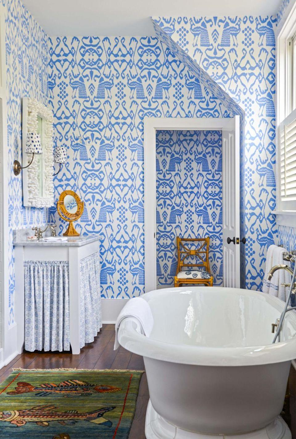 """<p>Speaking of pattern-happy: This bathroom by <a href=""""https://www.housebeautiful.com/design-inspiration/house-tours/a30696941/charlotte-barnes-palmetto-bluff/"""" rel=""""nofollow noopener"""" target=""""_blank"""" data-ylk=""""slk:Charlotte Barnes"""" class=""""link rapid-noclick-resp"""">Charlotte Barnes </a>is a blue-and-white dream, and continuing the same Quadrille pattern into the adjacent room makes for a satisfying visual. </p>"""