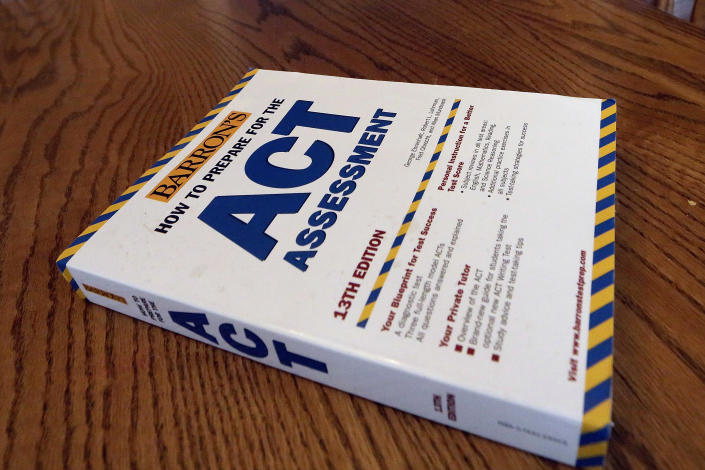 In this Tuesday, April 1, 2014 photo, an ACT Assessment preparation book is seen in Springfield, Ill. (AP Photo/Seth Perlman)
