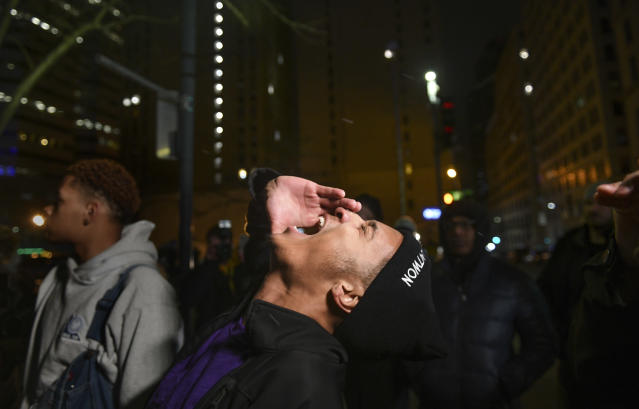 Kahlil Darden, center, and other supporters of Antwon Rose II react after they learned a not guilty verdict in the homicide trial of former East Pittsburgh police Officer Michael Rosfeld, Friday, March 22, 2019, at the Allegheny County Courthouse in downtown Pittsburgh, Pa. A jury acquitted Rosfeld, a former police officer Friday in the fatal shooting of Antwon Rose II, an unarmed teenager as he was fleeing a high-stakes traffic stop outside Pittsburgh, a confrontation that was captured on video and led to weeks of unrest. (Michael M. Santiago/Pittsburgh Post-Gazette via AP)