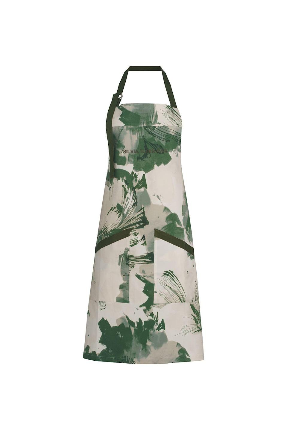 """<p>silviatcherassi.com</p><p><strong>$80.00</strong></p><p><a href=""""https://www.silviatcherassi.com/us/en/shop/products/jasmine-overall-green-floral"""" rel=""""nofollow noopener"""" target=""""_blank"""" data-ylk=""""slk:Shop Now"""" class=""""link rapid-noclick-resp"""">Shop Now</a></p><p>""""These fun aprons/overalls are made from up-cycled fabrics from the brand's RTW collections and they are great for all at home activities from cooking, to painting, to flower arranging!""""</p>"""