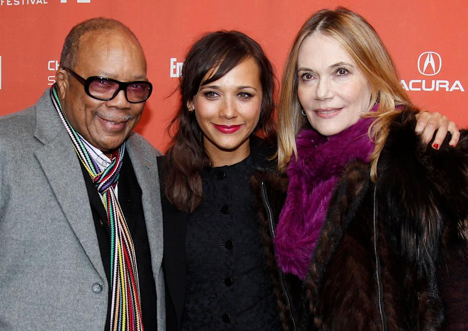 """Actress Rashida Jones, left, poses with her father Quincy Jones, left, and her mother Peggy Lipton, right, at the premiere of """"Celeste and Jesse Forever"""" at the 2012 Sundance Film Festival in Park City, Utah on Friday, Jan. 20, 2012. (AP Photo/Danny Moloshok)"""