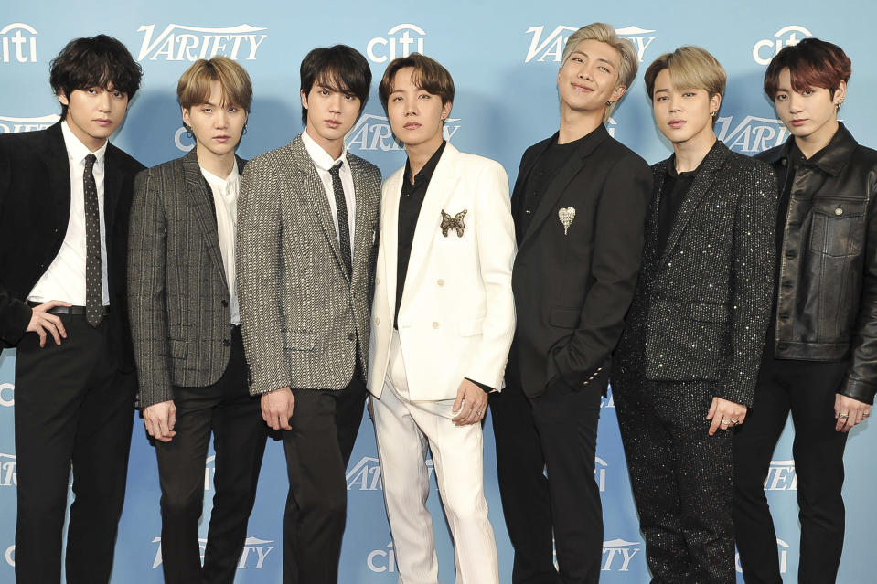 """FILE - Korean pop band BTS attends the 2019 Variety's Hitmakers Brunch in West Hollywood, Calif., on Dec. 7, 2019. The South Korean boy band BTS HAS won a leading four awards including best song for """"Dynamite"""" and best group at the MTV Europe Music Awards Sunday, Nov. 8, 2020 while Lady Gaga took home the best artist prize.(Photo by Richard Shotwell/Invision/AP, File)"""