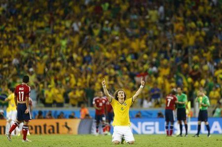 Brazil's David Luiz celebrates at the end of the 2014 World Cup quarter-finals between Brazil and Colombia at the Castelao arena in Fortaleza July 4, 2014. REUTERS/Marcelo Del Pozo