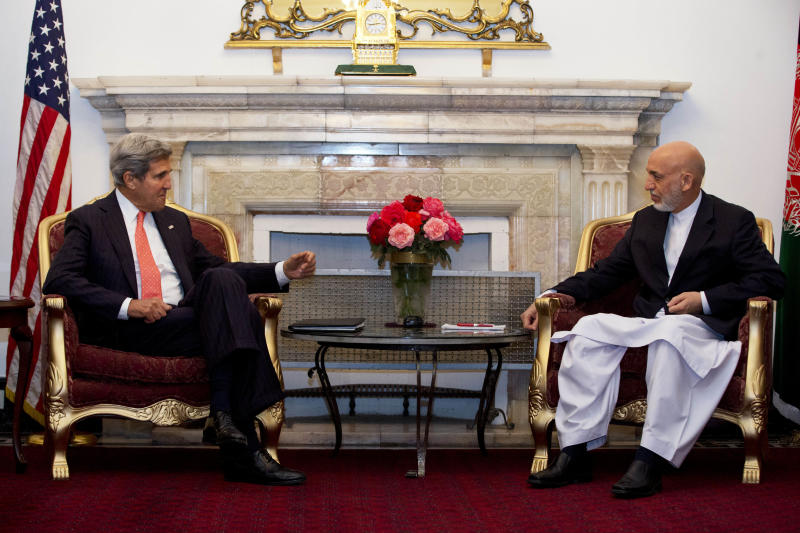 U.S. Secretary of State John Kerry, left, meets with Afghan President Hamid Karzai at the Presidential Palace during an unannounced stop in Kabul, Afghanistan, Friday, Oct. 11, 2013. Kerry flew to Afghanistan Friday for urgent talks with Afghan President Hamid Karzai as an end of October deadline looms for completing a security deal that would allow American troops to remain in Afghanistan after the end of the NATO-led military mission next year. (AP Photo/Jacquelyn Martin, Pool)
