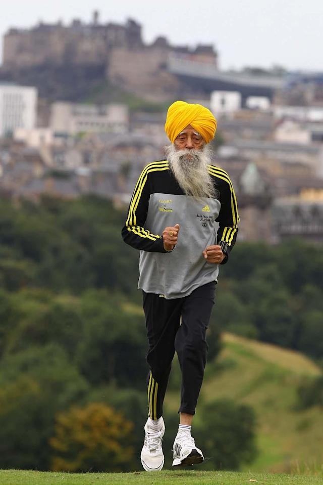 EDINBURGH, SCOTLAND - SEPTEMBER 01: Centenarian Sikh runner Fauja Singh poses for pictures after being the first person to officially enter for next year's Edinburgh Marathon on September 1, 2011 in Edinburgh, Scotland. A world record holder, aged 100, Fajua Singh has run seven marathons, all after his 89th birthday. He officially opened the entry process by signing up for his last ever 26 mile event in Edinburgh. (Photo by Jeff J Mitchell/Getty Images)