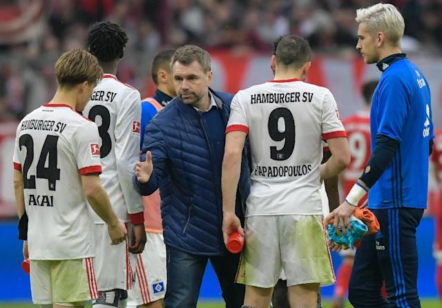 Bernd Hollerbach with Hamburg players at the end of Saturday's 6-0 drubbing at the hands of Bayern Munich (AFP Photo/Guenter SCHIFFMANN)
