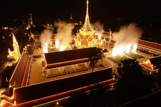 "Fireworks explode at the site of cremation for Cambodia's former King Norodom Sihanouk in Phnom Penh, Cambodia, Monday, Feb. 4, 2013. Hundreds of thousands of mourners gathered in Cambodia's capital Monday for the cremation of Sihanouk, the revered ""King-Father,"" who survived wars and the murderous Khmer Rouge regime to hold center stage in the Southeast Asian nation for more than half a century. (AP Photo/Heng Sinith)"