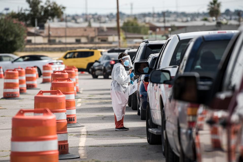 EL PASO, TX - OCTOBER 31: An attendant talks to a person waiting in their car at a coronavirus testing site at Ascarate Park on October 31, 2020 in El Paso, Texas. As El Paso reports record numbers of active coronavirus cases, the Texas Attorney General sues to block local shutdown orders. (Photo by Cengiz Yar/Getty Images)