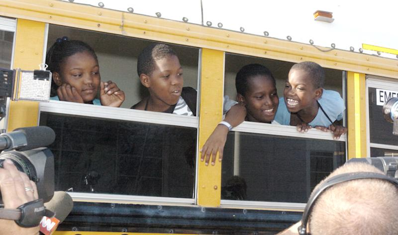 Children head off to their first day of school in Houston on Sept. 8, 2005, in the aftermath of Hurricane Katrina. (Reuters Photographer / Reuters)