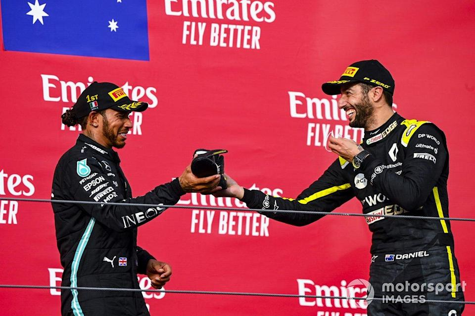 """Race Winner Lewis Hamilton, Mercedes-AMG F1 and Daniel Ricciardo, Renault F1 celebrate on the podium with a shoey<span class=""""copyright"""">Mark Sutton / Motorsport Images</span>"""