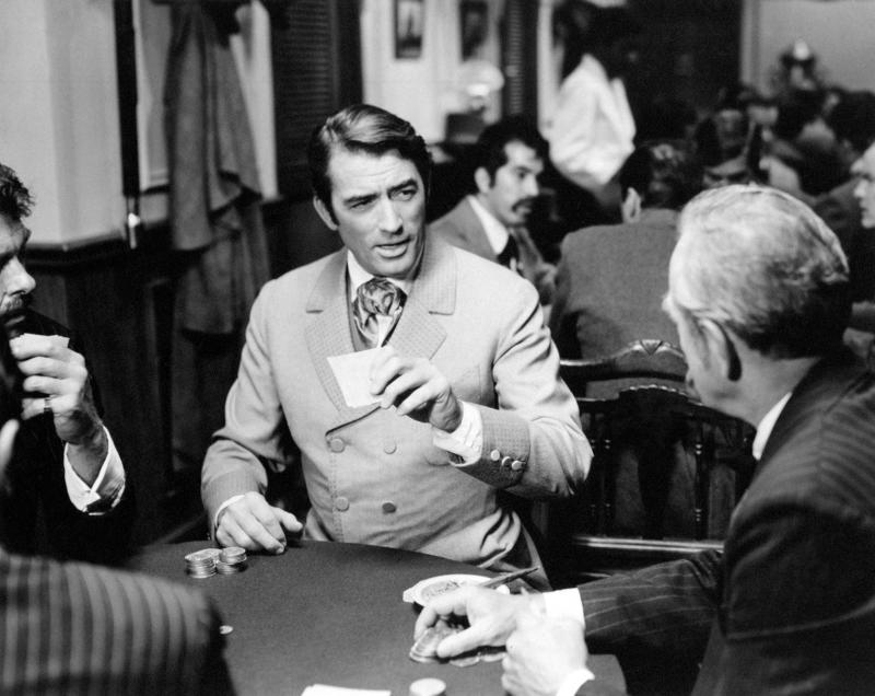 American actor Gregory Peck playing cards in a saloon in the film How the West Was Won. USA, 1962 (Photo by Mondadori via Getty Images)