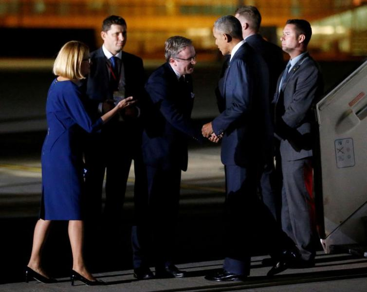FILE PHOTO: Polish presidential aide Krzysztof Szczerski greets then U.S. President Barack Obama as he arrives in Poland for a NATO Summit in 2016