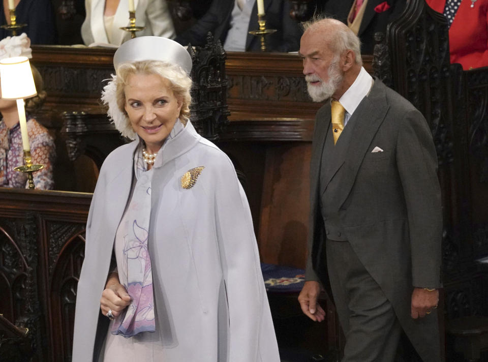 Britain's Prince Michael of Kent and Princess Michael of Kent take their seats ahead of the wedding of Princess Eugenie
