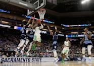 <p>Dylan Ennis #31 of the Oregon Ducks drives to the bsaket against E.C. Matthews #0 of the Rhode Island Rams during the second round of the 2017 NCAA Men's Basketball Tournament at Golden 1 Center on March 19, 2017 in Sacramento, California. (Photo by Jamie Squire/Getty Images) </p>