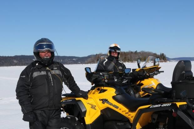 Long Island in the Kennebecasis River was once a thriving farming settlement. Now it's a mecca for hikers, snowshoers and ATVers like Frank Buck, left, and Ted Harley, right. Buck and Harley spend a lot of time on maintaining island trails.  (Julia Wright / CBC - image credit)