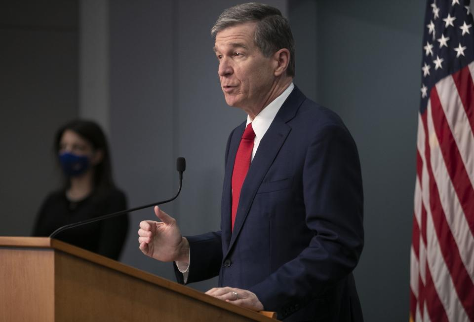 North Carolina Governor Roy Cooper speaks during a press briefing on the COVID-19 virus and vaccination efforts on Tuesday, March 2, 2021, at the Emergency Operations Center in Raleigh, N.C. (Robert Willett/The News & Observer via AP)