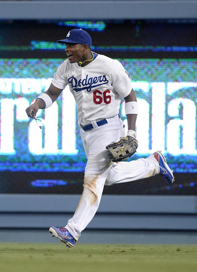 LOS ANGELES, CA - JUNE 03: Yasiel Puig #66 of the Los Angeles Dodgers celebrates his throw to first base for a double play to end the game and preserve a 2-1 win over the San Diego Padres during the eighth inning at Dodger Stadium on June 3, 2013 in Los Angeles, California. Puig defected from Cuba. (Photo by Harry How/Getty Images)
