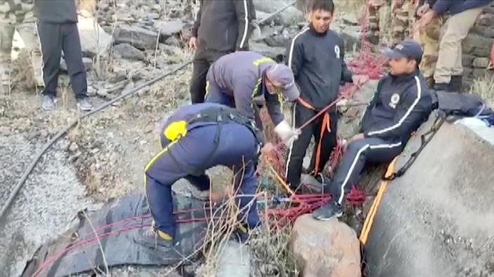 Image: Rescue personnel adjust ropes during rescue operation after a glacier burst, Feb. 7, 2021, in Chamoli, Uttarakhand, India. (State Disaster Force / Reuters)