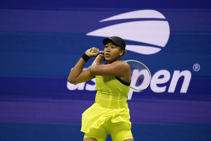 Naomi Osaka, of Japan, returns a shot to Leylah Fernandez, of Canada, during the third round of the US Open tennis championships, Friday, Sept. 3, 2021, in New York. (AP Photo/John Minchillo)
