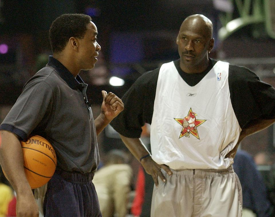 NBA Eastern Conference All Star coach Isiah Thomas talks with Washington Wizards' Michael Jordan during practice for the 2003 NBA All Star Game in Atlanta Saturday, Feb. 8, 2003. (AP Photo/John Bazemore)