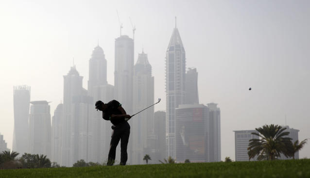 Tiger Woods from the U.S. plays a ball on the 13th hole during the second round of the Dubai Desert Classic golf tournament in Dubai, United Arab Emirates, Friday Jan. 31, 2014. (AP Photo/Kamran Jebreili)