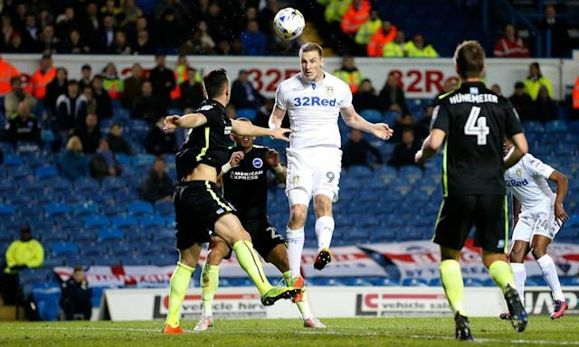 "<span class=""element-image__caption"">Chris Wood scores Leeds' first goal in the 2-0 win over Brighton with a towering header.</span> <span class=""element-image__credit"">Photograph: John Clifton/Reuters</span>"