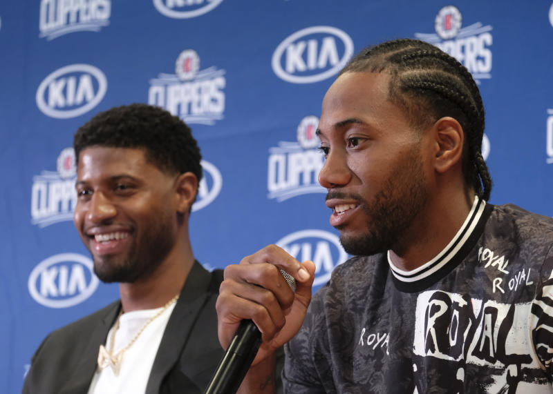 Los Angeles Clippers NBA basketball team introduce Paul George and Kawhi Leonard at a press conference at the Green Meadows Recreation Center in Los Angeles, Wednesday, July 23, 2019. (AP Photo/Ringo H.W. Chiu)