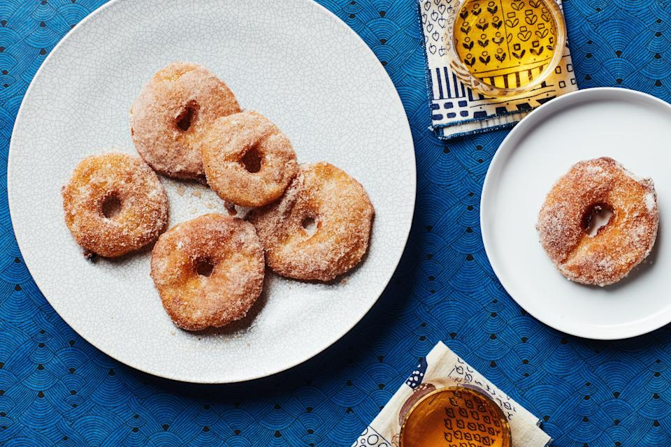 """Cinnamon, cardamom, and freshly ground black pepper lend warm spice to these sweet fritters. Any firm apple works well here. Try Honeycrisp or Pink Lady for sweet floral notes, or Granny Smith, if you prefer a little tartness. A mix of apples is also fun. <a href=""""https://www.epicurious.com/recipes/food/views/apple-fritters-with-spiced-sugar?mbid=synd_yahoo_rss"""" rel=""""nofollow noopener"""" target=""""_blank"""" data-ylk=""""slk:See recipe."""" class=""""link rapid-noclick-resp"""">See recipe.</a>"""