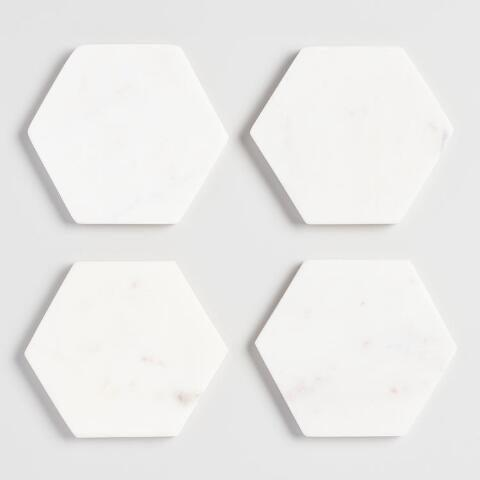 """<br><br><strong>World Market</strong> White Marble Hexagon Coasters Set of 4, $, available at <a href=""""https://go.skimresources.com/?id=30283X879131&url=https%3A%2F%2Fwww.worldmarket.com%2Fcategory%2Fdining%2Fbar%2Fbar-accessories.do"""" rel=""""nofollow noopener"""" target=""""_blank"""" data-ylk=""""slk:Cost Plus World Market"""" class=""""link rapid-noclick-resp"""">Cost Plus World Market</a>"""