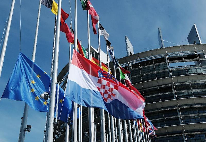 The Croatian flag is raised during a ceremony marking its accession to the European Union, July 1, 2013, at the European Parliament in Strasbourg, eastern France (AFP Photo/Frederick Florin)