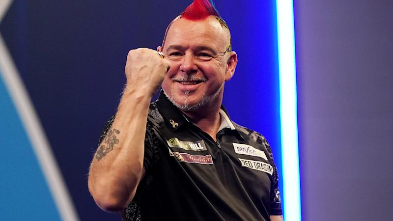 Peter Wright, pictured here celebrates his victory over Gerwyn Price.
