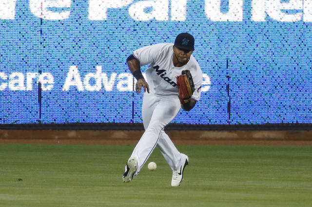 Miami Marlins right fielder Cesar Puello fields a ball hit by San Diego Padres' Manny Machado during the first inning of a baseball game Wednesday, July 17, 2019, in Miami. (AP Photo/Wilfredo Lee)