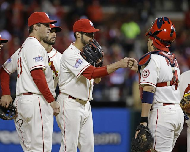 St. Louis Cardinals starting pitcher Joe Kelly is congratulated by catcher Yadier Molina before being taken out of the game during the sixth inning of Game 3 of baseball's World Series against the Boston Red Sox Saturday, Oct. 26, 2013, in St. Louis. (AP Photo/Matt Slocum)
