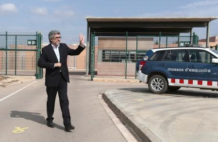 Lawyer Jordi Pina waves to supporters as he leaves the Lledoners prison in Catalonia where jailed Catalan leaders awaited a verdict in a trial over a banned independence referendum in Sant Joan de Villatorrada