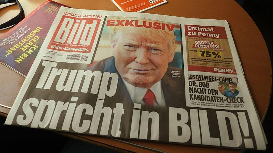 In this photo illustration of German tabloid Bild Zeitung that features an exclusive interview with then US President-elect Donald Trump