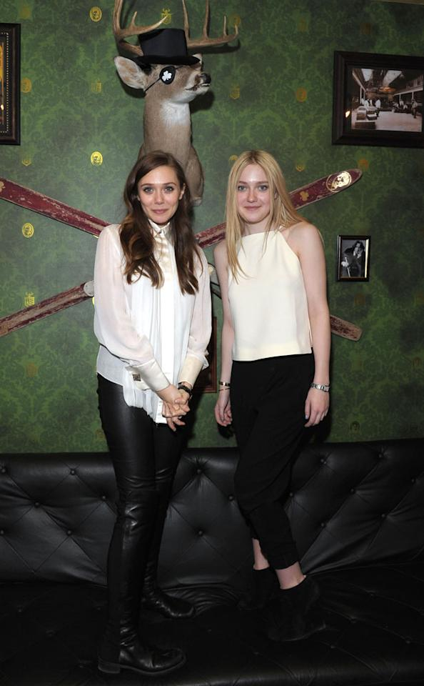"PARK CITY, UT - JANUARY 23:  Actors Elizabeth Olsen and Dakota Fanning attend ""Very Good Girls"" Official Cast and Filmmakers Lunch Sponsored by Fresh on January 23, 2013 in Park City, Utah.  (Photo by Michael Loccisano/Getty Images)"