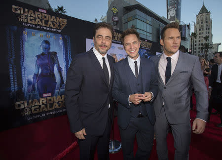 """Director of the movie Gunn poses with cast members Del Toro and Pratt at the premiere of """"Guardians of the Galaxy"""" in Hollywood"""